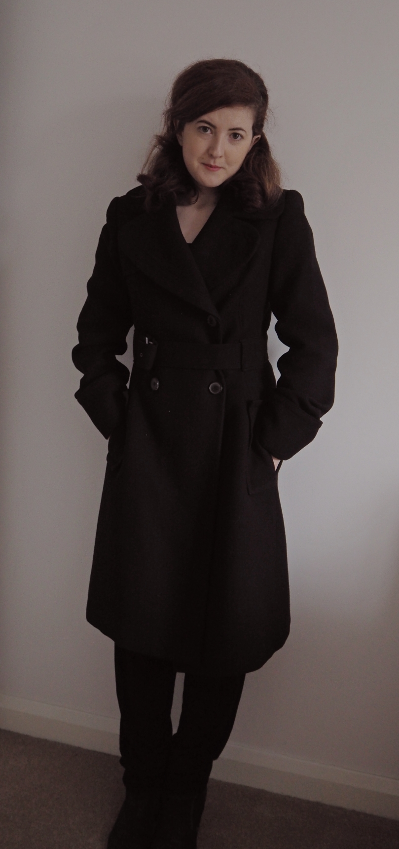 BLACK COAT - a day at a time.jpg